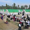 Schoolgirls coming out of Temporary Learning Spaces that Norwegian Refugee Council (NRC) under Sida funded projected provided to Camp Adha high school outside Jalalabad city in eastern Afghansitan. <br /> <br /> The school doesn't have a building and the students spend the entire school day out under trees in the open air. It has been going on for more than a decade as the Ministry of Education of Afghanistan failed to come to an agreement with Ministry of Agriculture, Irrigation and Livestock of Afghanistan to build classrooms for this school. The headmaster of the school, Auzubillah, stated that they established the school on ministry of agriculture farm when thousands of returnees came from Pakistan and many displaced internally in the area. According to him, the ministry of agriculture authorities doesn't allow the ministry of education to use the land as school. The school authorities in attempt to carry on studying, continued classes in the open air in the past decade. <br /> Norwegian Refugee Council (NRC) with support from Sida has provided ten tents to this school, befitting a total of 1,000 school children in makeshift classrooms.<br /> Photo: NRC/Enayatullah Azad, Nangarhar