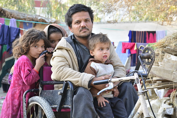 Shah Mahmood, 28, returned from Pakistan three months ago and is now living in Nangarhar, Afghanistan. The father of three is paralyzed and can't work. While in Pakistan, he had a pushcart and was selling some food items and cold drinks outside of a public school in Khyebr Pakhtunkhwa, earning around Rs1000 (approx. $15) a day. <br /> Tough he is happy being back in his own country, he is now without a job. Shah Mahmood says that they had a comfortable life back in Pakistan and now, everything has changed for them. He is living in a rented open space with no facilities. <br /> The Norwegian Refugee Council has provided the family with a tent to stay, with support from Sida.<br /> Photo: NRC/Enayatullah Azad, Nangarhar