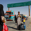 An Afghan family deported from Iran makes it's way to the border town of Zaranj, Nimroz province. (NRC/Jim Huylebroek)