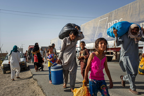 Afghans deported from Iran make their way to the border town of Zaranj, Nimroz province. (NRC/Jim Huylebroek)