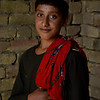 Abdul Ghayas, 15 years old inside his under construction house in Kunduz city funded by NRC. <br /> <br /> There was an explosion in his family home, caused by a gas cylinder. His mother, father and siblings were killed. Now he, his sister and grandmother live with an uncle. NRC selected them as beneficiary for shelter program. His house is almost completed and soon he will shift to his new house.<br /> <br /> Abudl Ghayas's family returned from Quetta, Pakistan in 2016, not long before the accident happened. <br /> Abdul Ghayas was going to Madrassa and does not want to go anymore. He never got the chance to go to school. He prefers to go to school instead of Madrasa if he got a chance. <br /> <br /> The uncle (Haji Sayed Gul) has engaged him to a 12-year-old girl just a week ago.<br /> Photo: NRC/Enayatullah Azad