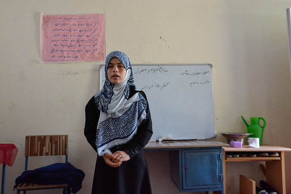 Salma (13) is originally from Khanabad District. Her family came to Kunduz city due to increased conflict in their village 1 year ago. <br /> <br /> She has 7 brothers and 3 sisters. Her father is working as a police man in the area around the Kunduz airport. <br /> <br /> Salma was not going to school in Khanabad, as her father wasn't able to buy her books and pens. The school was also too far away from their home she said.<br /> <br /> Girls were traditionally not going to school in their village. Now it is OK for her to go to school, as the project is supported and in the responsibility of the local community.<br /> <br /> Salma can now read and write, and wants to become a teacher for girls that are not able to go to school.<br /> Photo: NRC/Enayatullah Azad