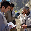 """NRC head of program, William Carter and area manager for east Rahimgul Amin, talking to newly arrived Rostam at the zero point.<br /> <br /> Rostam, 32, father of eight felt forced to return to Afghanistan from Pakistan. Rostam's family have left the country during 1980s. He was born in Pakistan and was living in Miskin Camp, Khyber pashtonkhwa, Pakistan. <br /> We met Rostam at the Torkham crossing (border between Afghanistan and Pakistan) minutes after he arrived in Afghanistan. Coming back into his native country, Rostam wept as he recounted the hardships his family had faced in their years as refugees in Pakistan. Also, being in his own country, he has no idea where to go<br /> """"I only have my late father's national identity document, which is now 60 years old. I don't have land. I don't have a house. I only have children. If anyone even puts a tent on a mountain, we will live there. If not, only Allah will protect us"""" he says.<br /> His late father's Tazkeera (identity paper) shows they are from eastern province of Laghman. <br /> """"I only want shelter to be protected, where my children could study and go to school, otherwise my children would be the same like me,"""" he added.  <br /> Photo: NRC/Enayatullah Azad"""