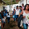 Parents and teachers walking to new school room