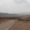 The road to Markazi camp from Djibouti, along the Red Sea coast.  The Markazi refugee camp is located around three hours drive from Djibouti City, to the North, just outside Obock. <br /> <br /> The Markazi refugee camp was set up in 2015, in response to the refugees fleeing conflict in Yemen, especially from the fighting in the south just across the Ban al Mandab strait. At that time, the camp hosted around 3000 refugees, now, there are around 1800 people living here. Some moved to family members elsewhere in the country, some returned to Yemen, while some moved to countries elsewhere. <br /> <br /> NRC is present in the camp, most significantly though water and sanitation services. <br /> <br /> Photo: NRC/Alvhild Stromme