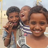 Aisha is 8 yrs old, Bab al Mandab. In the background: Ma'ana from Dhubab in Yemen and his friend.