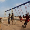 Alofa (10, yellow dress)<br /> Saed (2 on the swing)<br /> Dawood (7, on the swing) <br /> Behind: Ma'na' (striped shirt).