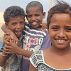Aisha is 8 yrs old, Bab al Mandab.<br /> <br /> In the background: Ma'ana from Dhubab in Yemen and his friend.