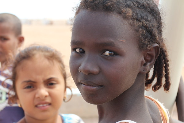 Zainab is 10 years old. She is not from Yemen, but Obock close by the camp. In the background is Mihad, 8 years old, from Dhubab in Yemen.