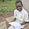 Magong reading his exercise book in the school compound during class break. <br /> <br /> Kule, Gambella. ALP is funded by UNHCR, NMFA and NRC Private Donors. <br /> <br /> Photo: NRC/Emebet Abdissa