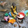 Nuer woman washing clothes at Gure camp
