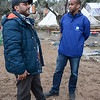 Protection officer Abdifatah Ahmedy is seconded from NRC´s emergency roster NORCAP to support UNHCR at Lesvos. He is working at Moria registration centre. Here he is speaking with Reza from Iran outside the registration centre. Photo: Tiril Skarstein, NRC