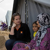 Rebecca Dibb talking to a little girl and her mother in Domiz camp in Iraq, a camp for refugees from Syria. Photo Credit: NRC/Ingrid Prestetun