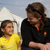 Rebecca Dibb talking to a little girl in Domiz camp in Iraq, a camp for refugees from Syria. Photo Credit: NRC/Ingrid Prestetun