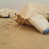 Heavy sandstorm broke out in Al Waffa camp for newly displaced IDPs from Anbar and destroyed around 100 tents. NRC's team who was present during the storm had to postpone the emergency response distribution.<br /> Photo: Balil Jaloob /NRC