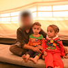 """Hasan, his wife, three children and his mother have fled Mosul and sought refuge in Debaga camp. He risked his life and his family's in order to reach safety.<br /> <br /> """"I have been here since July. It took us 15 days to get a tent.<br /> My mother use to receive a pension every two months and we use to try not to spend a lot until we receive the following one.<br /> Living conditions were difficult there; whoever doesn't have a pension cannot survive.<br /> People supported each other, but those who weren't supported used to skip meals.<br /> -How many people are there in your family? <br /> I live here with my wife, three children and my mother.<br /> I am a member at the Ministry of Defense. We were persecuted there. Whoever belonged to the Ministry was killed. <br /> That's why my family was forced to flee. If my family had stayed, they would have been hurt.<br /> Life here in the camp is difficult too; we have access to very few services.<br /> We were provided with a tent, but there is much water and aid is scarce. <br /> My oldest boy needs two more years before he can go to school. But we are focusing now on how to help our kids survive here.<br /> It is more important than their education. If one can barely survive here, how can they receive education?<br /> Children don't have anything to play with. They stay inside the tent.<br /> Their father or brother usually take them out for a walk around the camp's section and then return to the tent. There are no parks here.<br /> A kindergarten will soon open.<br /> Things are feeling worse. We don't see anything that will make us foresee any positive outcomes. It's just going from bad to worse.<br /> I don't think we will return soon, because people there tell us that it is becoming stricter inside Mosul and the army hasn't retaken Ninawa yet.<br /> My relatives there live in injustice and oppression. If you leave your home, you are almost sending yourself to your death.<br /> If you make any small mistake, th"""