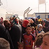 Newly displaced Iraqi families wait outside a distribution point in Debaga camp where NRC provides water, food parcels, hygiene and baby kits. The camp currently hosts more than 6,000 families who have fled their homes in Mosul, surrounding cities and elsewhere. <br /> <br /> Photo: Karl Schembri/NRC