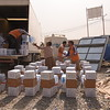 NRC staff preparing emergency food aid, water and hygiene kits at a distribution point in Debaga camp for newly displaced Iraqis. The camp currently hosts more than 6,000 families who have fled their homes in Mosul, surrounding cities and elsewhere. <br /> <br /> Photo: Karl Schembri/NRC