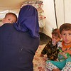 """Asil with her two month old son Kamal, her 3 year old son Ahmed in orange and her 2 year old daughter Noor. <br /> <br /> Asil (23) is a widowed mother of four young children who arrived to Debaga camp two days ago. She is from Haji Ali, a village on the outskirts of Makhmour southeast of Mosul where she used to live with her husband and children. <br /> When ISIS took over control of the Haji Ali village, they took Asil's husband. She never saw him again, except on a photo sent to her by ISIS showing her husband dead with a bullet in his head. <br /> """"He never got to see his youngest son,"""" Asil says looking down at two month old baby Kamal. She was pregnant at the time her husband was abducted and killed. """"But he [her husband] decided the name, he decided to call him Kamal, but he never got to see him"""".<br /> When Iraqi forces started launched the operation to take back Makhmour and the villages surrounding in early 2016, life had gotten very hard for Asil, now a widow caring for her four children alone.<br /> """"There was no more milk left for my children. I had to feed them water and sugar. That is why she looks so small,"""" Asil says and point to her two year old daughter Noor. <br /> Asil is planning on leaving the camp and head to Kirkuk where she has family. She has no salary or money herself and is hoping that a family member can support her and her children until she can return home.<br /> """"My biggest wish is to put my children in school and see them grow up to a better life,"""" Asil says. <br /> <br /> Photo: NRC/Becky Bakr Abdulla"""