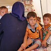 """Asil with her two month old son Kamal, her oldest son Ahmed (4 years in orange), her other son Tahir (3) and her daughter Noor (2) in the back.<br /> <br /> Asil (23) is a widowed mother of four young children who arrived to Debaga camp two days ago. She is from Haji Ali, a village on the outskirts of Makhmour southeast of Mosul where she used to live with her husband and children. <br /> When ISIS took over control of the Haji Ali village, they took Asil's husband. She never saw him again, except on a photo sent to her by ISIS showing her husband dead with a bullet in his head. <br /> """"He never got to see his youngest son,"""" Asil says looking down at two month old baby Kamal. She was pregnant at the time her husband was abducted and killed. """"But he [her husband] decided the name, he decided to call him Kamal, but he never got to see him"""".<br /> When Iraqi forces started launched the operation to take back Makhmour and the villages surrounding in early 2016, life had gotten very hard for Asil, now a widow caring for her four children alone.<br /> """"There was no more milk left for my children. I had to feed them water and sugar. That is why she looks so small,"""" Asil says and point to her two year old daughter Noor. <br /> Asil is planning on leaving the camp and head to Kirkuk where she has family. She has no salary or money herself and is hoping that a family member can support her and her children until she can return home.<br /> """"My biggest wish is to put my children in school and see them grow up to a better life,"""" Asil says. <br /> <br /> Photo: NRC/Becky Bakr Abdulla"""