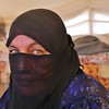 """Aysha is a widow who escaped the village of Haji Ali when war broke out there together with her two children. She has no salary or ways of supporting herself and her son is blind and in need of medical treatment. <br /> Aysha tried escaping her village 7 months ago, but when ISIS found out she was planning on fleeing, they stopped them and instead forced Aysha and her two children to move to an ISIS controlled village. There Aysha and her children stayed in a house that was under constant monitoring.<br /> """"We would hear bombs and explosion all the time, and was forced to flee and move locations together with ISIS four times."""" Aysha says. <br /> When the Iraqi forces advanced toward the village she was being kept in, Aysha saw her chance to finally escape on 11 June 2016. Together with approximately 300 other families, they fled towards the Tigris river and stayed by the rover side for several hours until someone managed to phone and call for help from a relative working for the Iraqi military forces. They were then brought to Debaga camp.<br /> """"I don't need anything else in my life except safety. As long as we are safe, we don't need much more,"""" Aysha says. <br /> <br /> Photo: NRC/Becky Bakr Abdulla"""