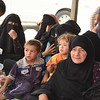 Hundreds of displaced Iraqis from Fallujah are seen stranded here in Amariyat Al Fallujah, just before the Bzeibiz Bridge, waiting to be allowed into Baghdad. <br /> NRC provides emergency food, water and hygiene kits to the displaced here but there are no facilities for the people stranded, sometimes for days.<br /> 18 June, 2016<br /> Photo: Karl Schembri/NRC