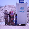 Women wait to use the only latrine on  a newly opened camp in Amariyat Al Fallujah hosting at least 3,000 individuals. Photo: Karl Schembri/NRC