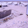 An open pit next to tents for the only latrine on the camp. Photo: Karl Schembri/NRC