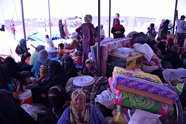 Dozens of families have been crammed outside this mosque for the last week since their displacement from Fallujah<br /> Photo: Karl Schembri/NRC