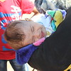 """Khazar camp, Hasansham, November 4, 2016<br /> <br /> Fadhila, from Gogjali. She does not want to expose her face, but this is her 3 months old baby. <br /> <br /> She came yesterday (3 November) 8am in the morning. <br /> <br /> """"We left because we were scared. The last. 2 ½ years have been exhausting.""""  <br /> <br /> """"I am very tired. There was no food, no studies. In the beginning we were happy with them (ISIS), we welcomed them, but they became bad.""""<br /> <br /> """"The battle between ISIS and the army was very tiring. We stayed two days in the house, then we walked to the army. We were walking for two nights, then the military took us on trucks, then we slept on the truck. We were running among the houses, we did not know what was happening.""""<br /> <br /> Photo: Alvhild Stromme/NRC"""