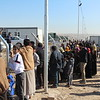 Khazar camp, Hasansham, November 4, 2016<br /> <br /> The new arrivals are not allowed to leave the camp, and family members are not allowed to come inside. They greet and talk through the fence, following more than two years of forced separation. <br /> <br /> Photo: Alvhild Stromme/NRC