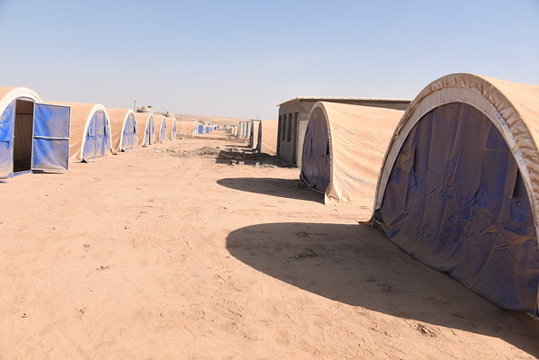 Hasan Sham Camp is one of several sites being set up to accommodate families fleeing from Mosul City. The camp is around 20 kilometres away from the city centre in Hamdaniya.<br /> Work is still ongoing--at present the newly set up camps can take up to 60,000 individuals, but up to 200,000 are expected to flee in the first days and weeks of the offensive.<br /> NRC will be working in this camp distributing emergency food aid, water and hygiene kits as well as organising education activities and psychosocial help for children.<br /> 18 October, 2016<br /> Photo: Karl Schembri/NRC