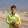 "Zyab Ismail (13) is internally displaced from the village of Shex Ahmed in Iraq and currently lives in Debaga camp. He loves playing football and his favourite team is the Spanish team of FC Barcelona. When we meet him, he is dressed in his football shirt proudly displaying the Barcelona logo: ""I really want to meet and take a photo with Lionel Messi one day,"" Zyab says referring to the team's forward star player. Zyab goes to NRC's school support centre in Debaga every day. <br /> NRC provides psychosocial support to help children cope with their new surroundings and any traumatic events they may have experienced. Through our Better Learning Program (BLP), we teach children deep breathing and stretching techniques that reduce stress and help improve focus. BLP also uses art as a way for children to process the events they've experienced in a positive manner, which has been proven to reduce things like nightmares and negative behaviour in the classroom.<br /> NRC's School Support Centre provides a safe space for children to play, learn and grow. Instructors have received training in how to work with conflict-affected children, and they tailor their games and activities to engage children in their new environment. Children play sports, engage in music and art activities, and also receive basic education classes to help prepare them to go back to school.<br /> <br /> Date: 6 November 2016<br /> Photo: NRC/ Sarhang Sherwany"