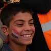 """I wanted to have the Iraqi flag on my face, because it is my country and I love it,"" Hawar Ahmed (12) says while one of NRC's education staff is painting his face at NRC's School Support Centre in Debaga camp. <br /> Iraqi IDP children who have been recently displaced have missed up to two years of important social and intellectual development. They may have been forced to attend ISIS schools, or not attended school at all.<br /> NRC provides psychosocial support to help children cope with their new surroundings and any traumatic events they may have experienced. Through our Better Learning Program (BLP), we teach children deep breathing and stretching techniques that reduce stress and help improve focus. BLP also uses art as a way for children to process the events they've experienced in a positive manner, which has been proven to reduce things like nightmares and negative behaviour in the classroom.<br /> NRC's School Support Centre provides a safe space for children to play, learn and grow. Instructors have received training in how to work with conflict-affected children, and they tailor their games and activities to engage children in their new environment. Children play sports, engage in music and art activities, and also receive basic education classes to help prepare them to go back to school.<br /> <br /> Date: <br /> Photo: NRC/Sarhang Sherwany"
