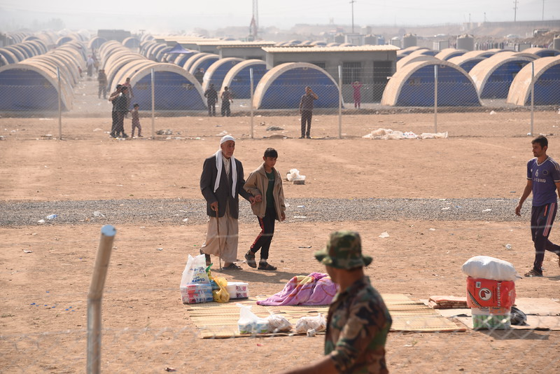 Newly arrived displaced Iraqis from Tub Zawa in the new Khazar Camp in Hasan Sham.<br /> Over 1,000 people fled their village overnight as Iraqi forces advanced towards Mosul city.<br /> NRC delivered emergency supplies including food, water, hygiene kits and baby supplies.<br /> Photo: Karl Schembri/NRC