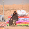 A woman from Tub Zawa rests next to emergency aid in Khazar Camp, Hasan Sham.<br /> Over 1,000 people fled their village overnight as Iraqi forces advanced towards Mosul city.<br /> NRC delivered emergency supplies including food, water, hygiene kits and baby supplies.<br /> Photo: Karl Schembri/NRC