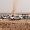 A sandstorm in the midst of Khazar Camp.<br /> Over 1,000 people fled their village overnight as Iraqi forces advanced towards Mosul city.<br /> NRC delivered emergency supplies including food, water, hygiene kits and baby supplies.<br /> Photo: Karl Schembri/NRC