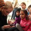 Marna Haugen playing with children .