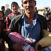 "Khazar camp, Hasansham, November 4, 2016<br /> <br /> Waed with his baby Firaz (2 months) <br /> <br /> From Al Masaraf, arrived yesterday (3. November) with his wife and five children. <br /> <br /> ""Everything was forbidden. For the last year, they had a database, they took people to the war. In the beginning, for the first eight months when ISIS arrived, they were ok, but then we got to know what they are really like. Because I have a back problem, my sons convinced them that they had to be with me and their mother, so they did not take them. I saw how they killed 120 people, I saw it, I am a witness. If you drink alcohol, immediately you get killed. I have a fine, a paper, they gave me a fine and 100 lashes. I had to pay 30 000 Iraqi Dinars, and take 100 lashes because they caught me with two boxes of cigarettes.""<br /> <br /> The fine states: <br /> <br /> ""This is a warning penalty. The penalty amounts to 30 000 Iraqi Dinar. Justification: Selling cigarettes.""<br /> <br /> Photo: Alvhild Stromme/NRC"
