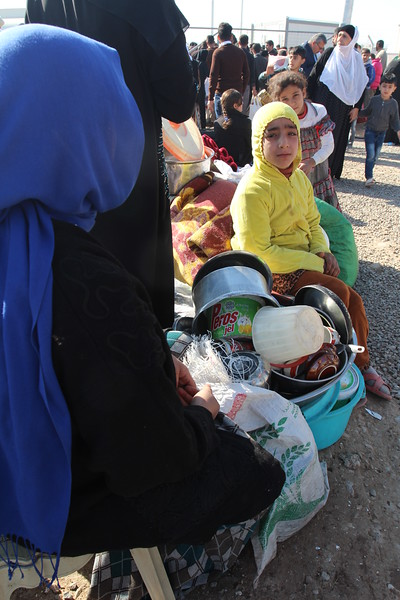 "Khazer camp, Hasansham, November 4, 2016:<br /> <br /> Woman, does not want to give her name. <br /> <br /> She has 11 children and is pregnant. She came from Gogjali yesterday (3. November) with a car. <br /> <br /> ""We did not sleep the last two nights before we came here. I had a good night sleep last night."" <br /> <br /> ""The last weeks there was no water, no electricity, we only survived on bread.""<br /> <br /> ""My husband used to work for TV, but he lost his job.""<br /> <br /> ""We didn't have anything to give to our children"". <br /> <br /> ""Before ISIS we used to live here in Hasansham, just over there, but they forced us to move to Mosul, they wanted us to live like a wall around them to protect them.""<br /> <br /> She is glad that they are safe now. She wants her children to go back to school and her husband to get a job again. <br /> <br /> Photo: Alvhild Stromme/NRC"