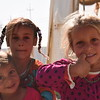 Displaced Iraqi girls standing at NRC's School Support Centre entrance in Debaga Camp. NRC is providing educational and psychosocial activities to around 1,800 displaced Iraqi children at the camp.<br /> <br /> Photo: Elias Abu Ata/NRC