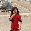 """Namira 7 years old. He is in the 2nd grade. Her home village is Khanasur in Sinjar, but for more than two years she has lived in this camp with her family. Namira loves reading, writing and drawing. She wants to be a teacher, she loves teachers. <br /> """"Once they organized a party for us, we were dancing"""" <br /> """"I miss my uncle, his house was next to our house. We ran to our cars and left and until now we could not go home""""<br /> The School Support Centre coordinator, Salim says: """"Namira is lucky, she had a family that takes very good care of her and for her education. She is very knowledgeable for her age, and it gives her confidence in the way she interacts with other, she is very mature for her age. I am sure she will become a good teacher, as she wants to, and we need good role models as her for other children.""""<br /> <br /> Bajed Kandala camp is located in the Kurdistan region in Northern Iraq, close to the border of both Turkey and Syria. It was initially set up to accommodate Syrian Refugees, but since June 2014 Yazidis fleeing violence in and around Sinjar have been living in the camp. The camp accommodates around 13,000 people, and the NRC education programme is serving up to 5000 children.  <br /> From the beginning, NRC established a School Support Centre to fill gaps in the formal education provided. Activities include supporting the children though the curriculum, other activities as sports, and they engage people to identify and visit children who have dropped out from school to encourage them to come back. <br /> The centre is becoming increasingly important as the formal education provided is suffering from lack of teachers. However, the school support programme is now scaling down and might close due to lack of funding. Closing the center would mean that the 5000 displaced children in the camp who need educational support more than ever, will have no access to education. It would also mean that the children's prospects for a brighter future outside"""
