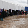 Women queue for food and water distributed by the Norwegian Refugee Council in the reception centre of the Hamam Al-Alil camp.<br /> <br /> Date:16 March 2017<br /> Photo: Sarhang Sherwany/NRC