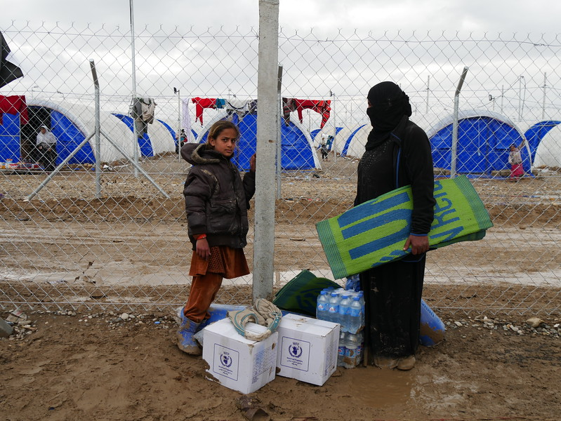 """Hussina Abid (42) is originally from Mosul. <br /> <br /> """"I came here Hama al-Ali nine days ago, I came with my seven daughters, four of them are disabled, the roads were dangerous but people and Iraqi army helped us to safety.<br /> Life had died. ISIS took everything from us and forced us to leave. They took my husband three months ago; I don't know where is he now. We are doing fine here since it is safe and we receive a lot of things here, and I am thankful for NRC for providing use these needs, but we still need more, especially water.""""<br /> <br /> """"Life is not the same without my husband, I hope he is still alive and gets back to us soon, I want to have the same joy with my family as we used to have before ISIS, but we would not have it without having my husband around.""""<br /> <br /> Date: 16 March 2017<br /> Text: Sarhang Sherwany<br /> Photo: Alan Jalal/NRC"""