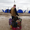 """Riaz (48) from Wadi Hajir on the west side of Mosul city just arrived in Hamam al-Alil with these bags that he and his wife brought with them. """"Life has died in Mosul, we did not have anything, ISIS took us to the train station in Babel Baiza and had us to stay there,"""" Riaz says.<br /> """"I hope everything gets better soon, and people live together peacefully,"""" Riaz adds.<br /> """"I love traveling, it is one of my hobbies, I have been many countries"""" Riaz says. <br /> <br /> Date: 16 March 2017<br /> Text : Sarhang Sherwany <br /> Photo: Alan Jalal"""