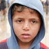 """Mohemed Sabah (6) originally from Mosul, has been displaced to Hamam al-Alil two weeks ago. """"I want education, safety, and joy for my children,"""" Mohemed's mother says while waiting in the queue to get aid """"I am thrilled that Mohemed is registered in school, he will go back to school again, I really hope he will finish school, and I want him to be a journalist to help people in the future,"""" she says. <br /> <br /> Date: 16 March 2017<br /> Text: Sarhang Sherwany<br /> Photo: Alan Jalal"""