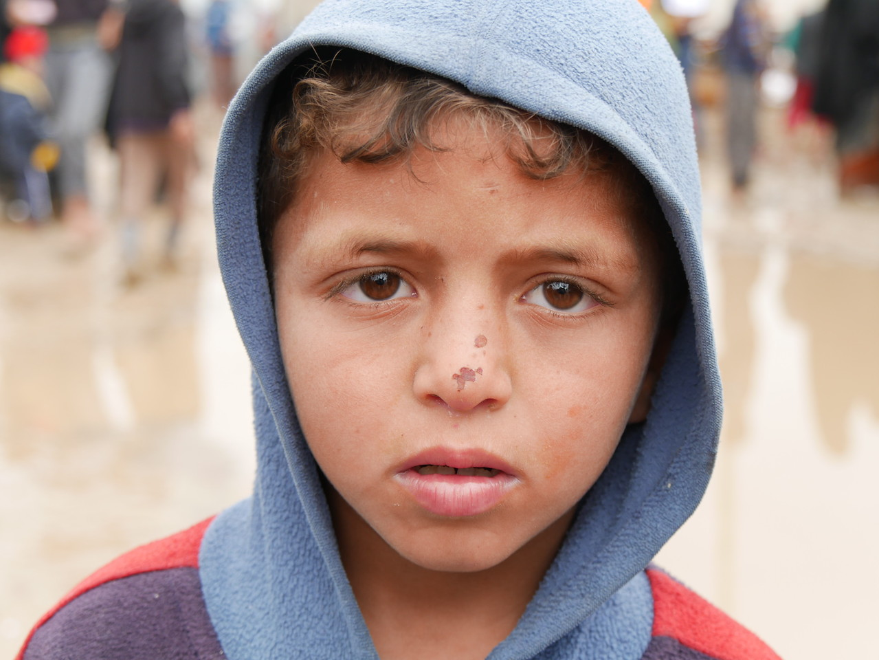 """Mohemed Sabah (6) originally from Mosul, has been displaced to Hamam al-Alil two weeks ago. """"I want education, safety, and joy for my children,"""" Mohemed's mother says while waiting in the queue to get aid """"I am thrilled that Mohemed is registered in school, he will go back to school again, I really hope he will finish school, and I want him to be a journalist to help people in the future,"""" she says.   Date: 16 March 2017 Text: Sarhang Sherwany Photo: Alan Jalal"""