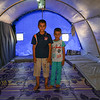 Ahmed with his younger brother in their tent in Khazer camp.<br /> <br /> Date: 15 June 2017<br /> Photo: Sarhang Sherwany/NRC