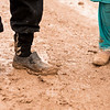 The shoes of a man and a girl, who arrived from Mosul yesterday, covered in mud in a camp for displaced people.<br /> <br /> Date: 04 March 2017<br /> Photo: NRC/Melany Markham