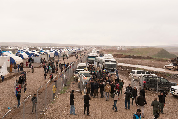 Buses carrying thousands of people displaced by fighting in Mosul arrive at the Khazer camp, south of the city.<br /> <br /> Date: 04 March 2017<br /> Photo: NRC/Melany Markham